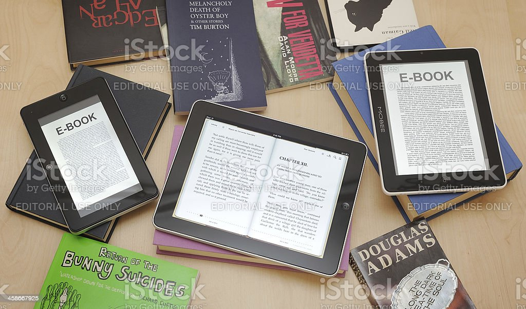 Digital Tablets and e-readers with books stock photo