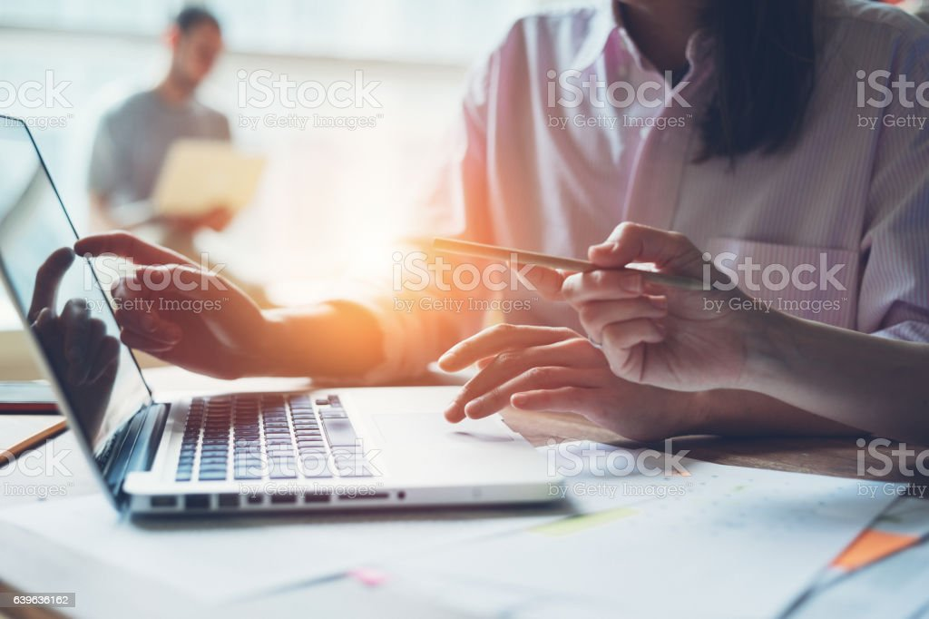 Digital team working on a project in big office stock photo