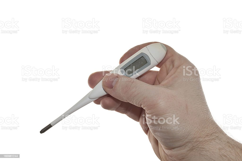 Digital thermometer in hand stock photo