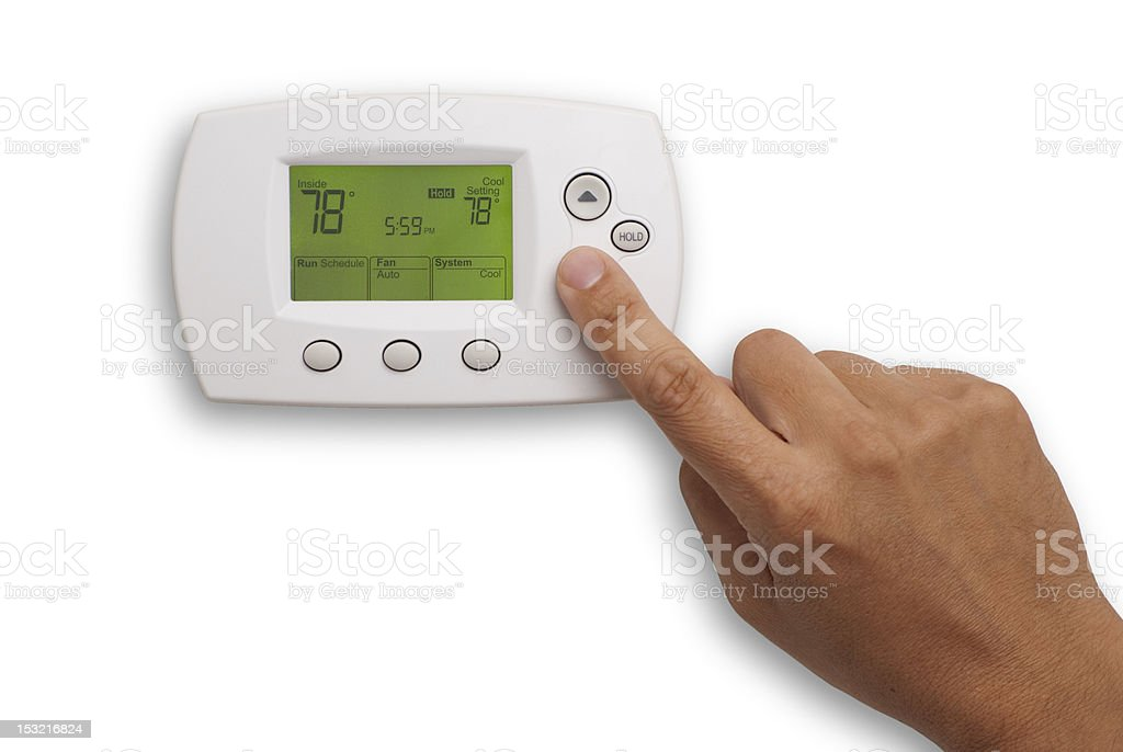 Digital Thermostat and male hand stock photo