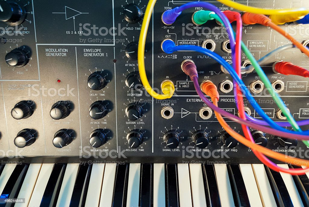 Digital voice synthesizer with colorful wires plugged in stock photo