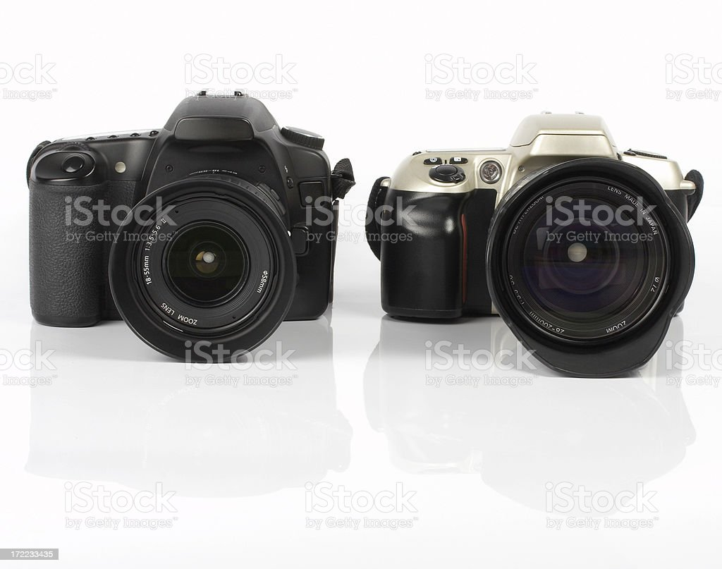 Digital vs. analogue SLR camera, isolated on white background royalty-free stock photo