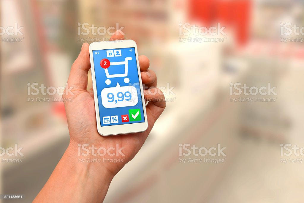 Digital wallet: paying with smartphone at counter stock photo