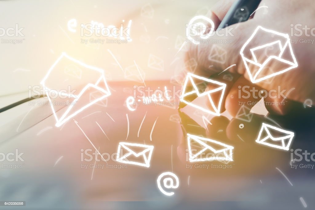 Digital writing mails using pen and tablet. stock photo