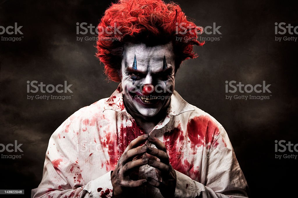 Digitally altered image of evil, bloody clown stock photo