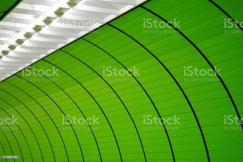 Digitally altered photo of tunnel brightly lit from above stock photo