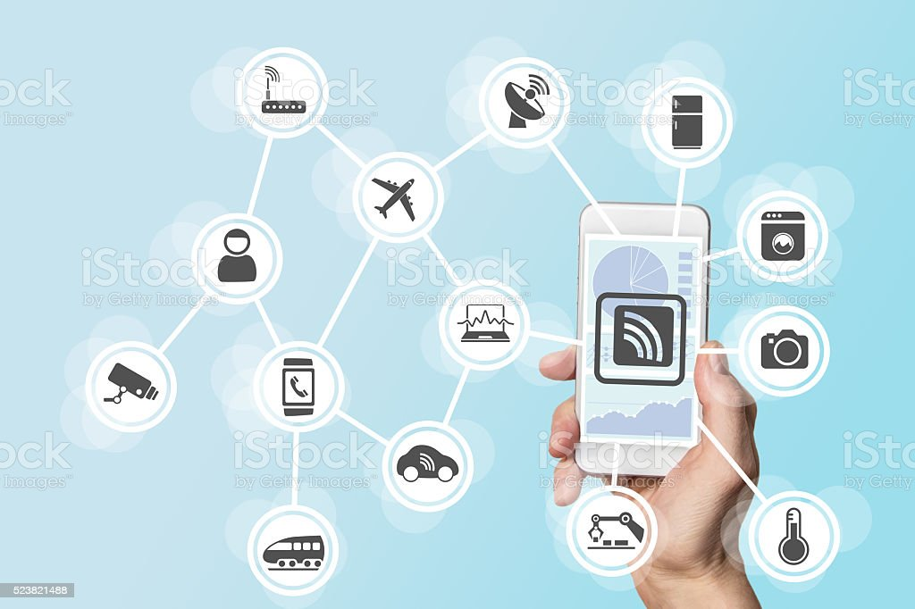 Digitization and mobility concept illustrated by hand holding smart phone stock photo