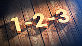 Digits 1-2-3 on wood planks