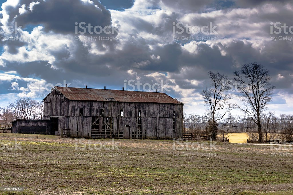 Dilapidated barn with dramatic sky stock photo