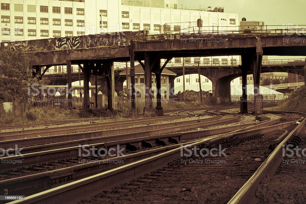 dilapidated bridge and commercial traintracks stock photo