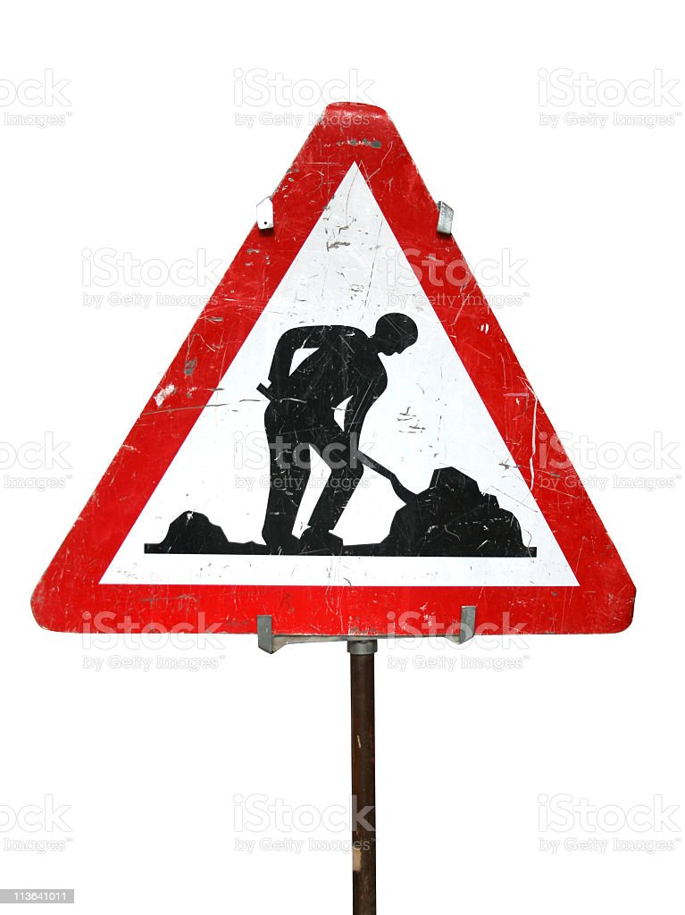 Dilapidated road works sign of man digging, attached to pole stock photo