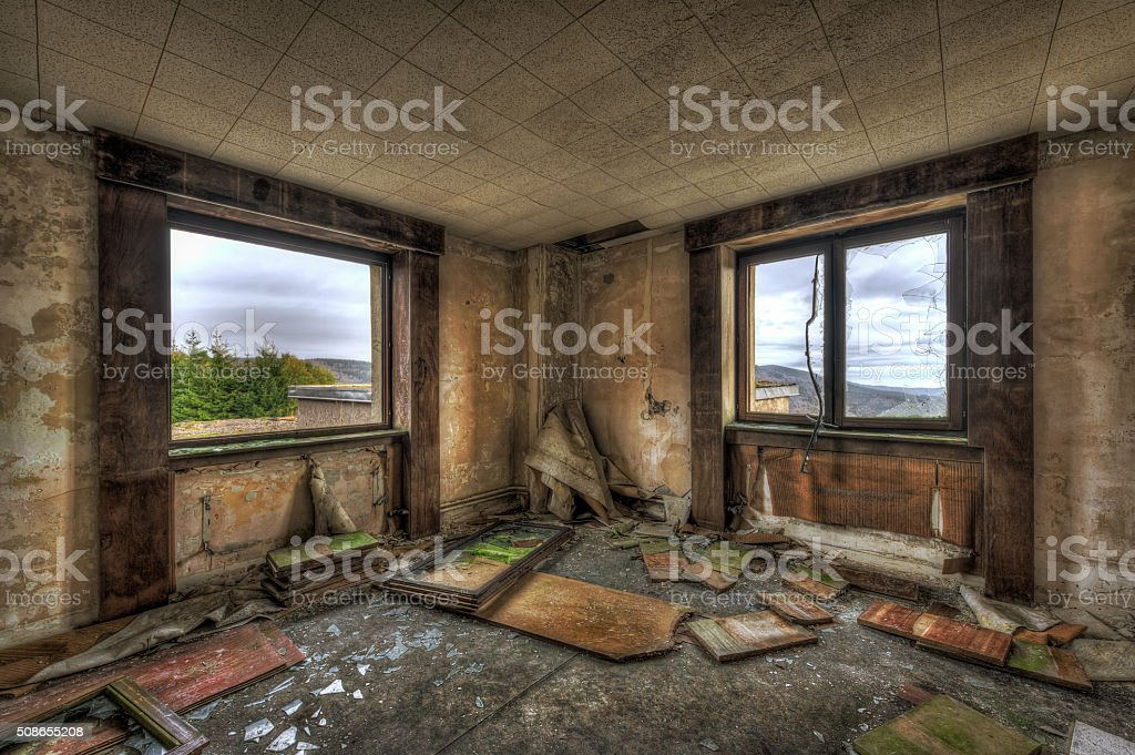Dilapidated room in an abandoned building stock photo
