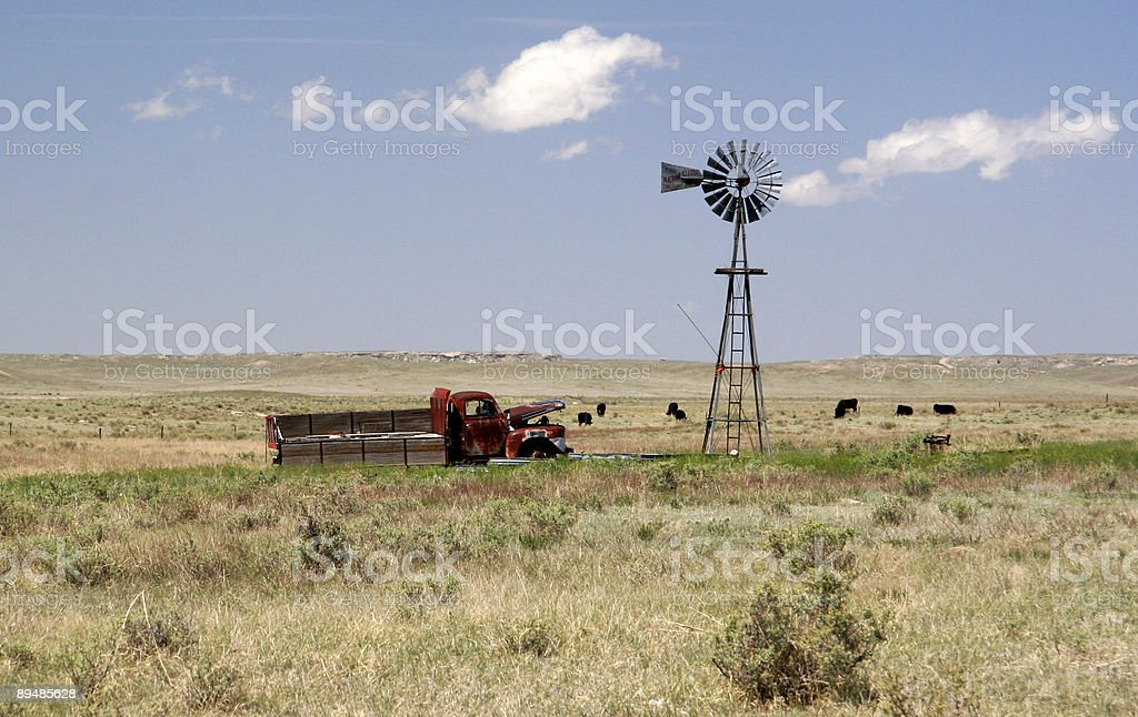 dilapidated windmill and rusty old truck royalty-free stock photo