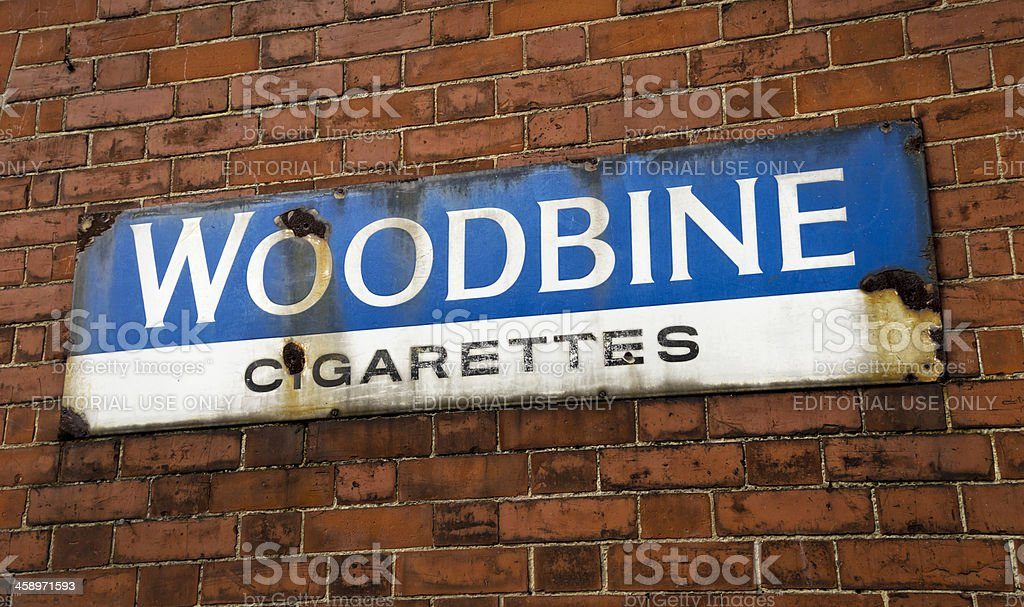 Dilapidated Woodbine cigarettes wall sign royalty-free stock photo