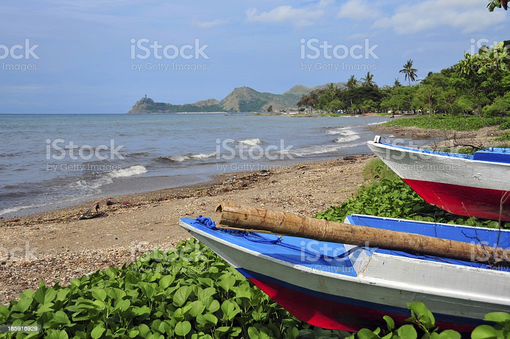 Dili, East Timor: downtown beach with fishing boats stock photo