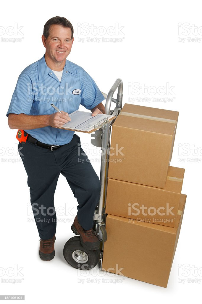 Dilvery Man Delivering Stack of Boxes On a Hand Truck royalty-free stock photo