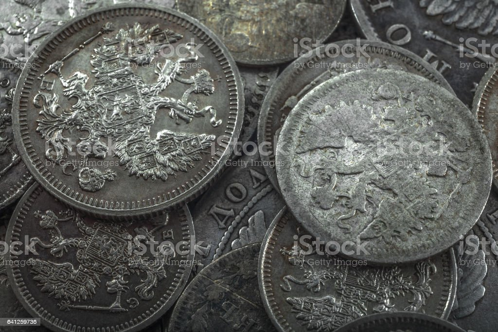 dim gloss of old silver coins stock photo
