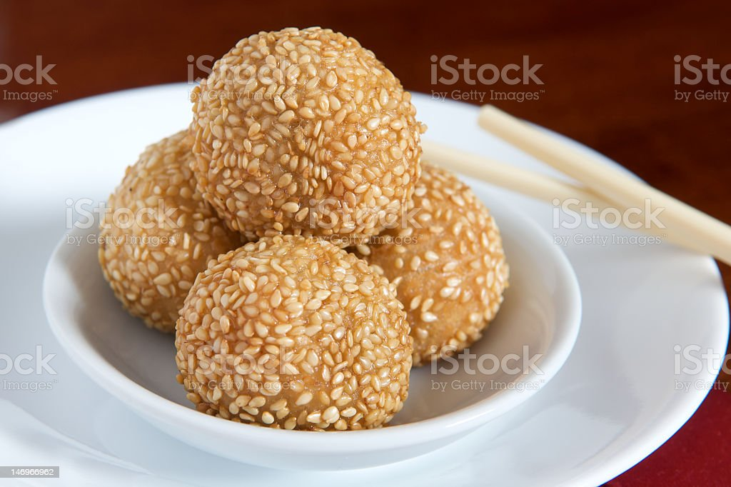 Dim Sum being served on a white plate with chopsticks stock photo