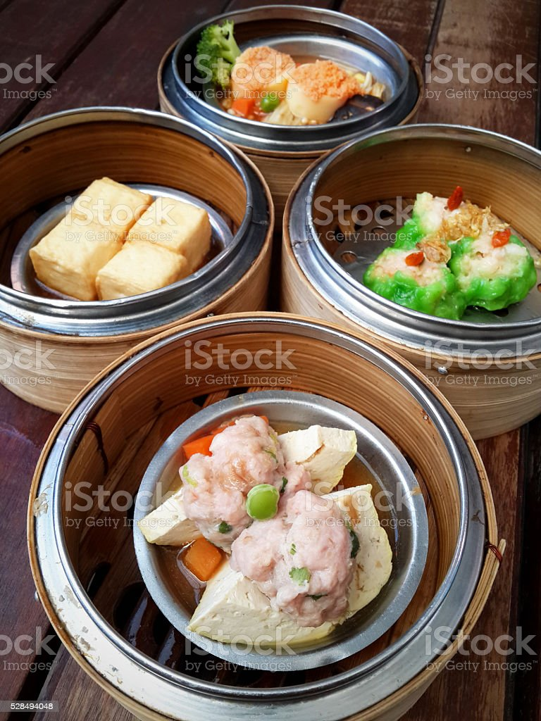 dim sum in bamboo steamer, chinese cuisine stock photo