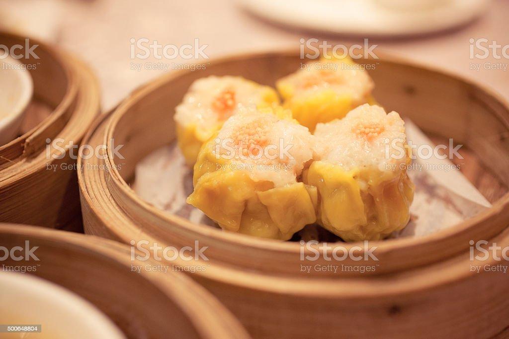 Dim Sum Steamed Pork Dumpling in Bamboo Basket stock photo