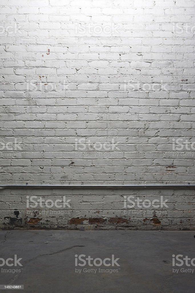 Dimly lit white brick wall royalty-free stock photo