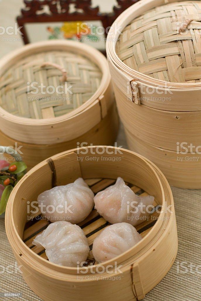 dimsum hagao - steamed dumplings in bamboo basket stock photo