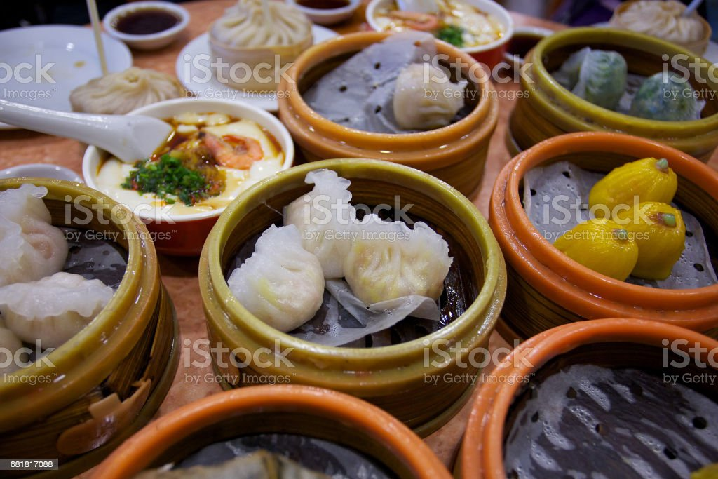 Dimsum , various chinese steamed dumpling in bamboo steamer in chinese restaurant . stock photo