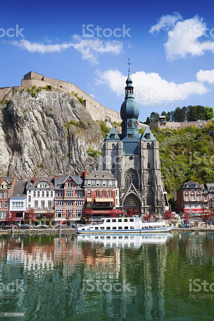 Dinant Collegiate Church on Meuse river stock photo