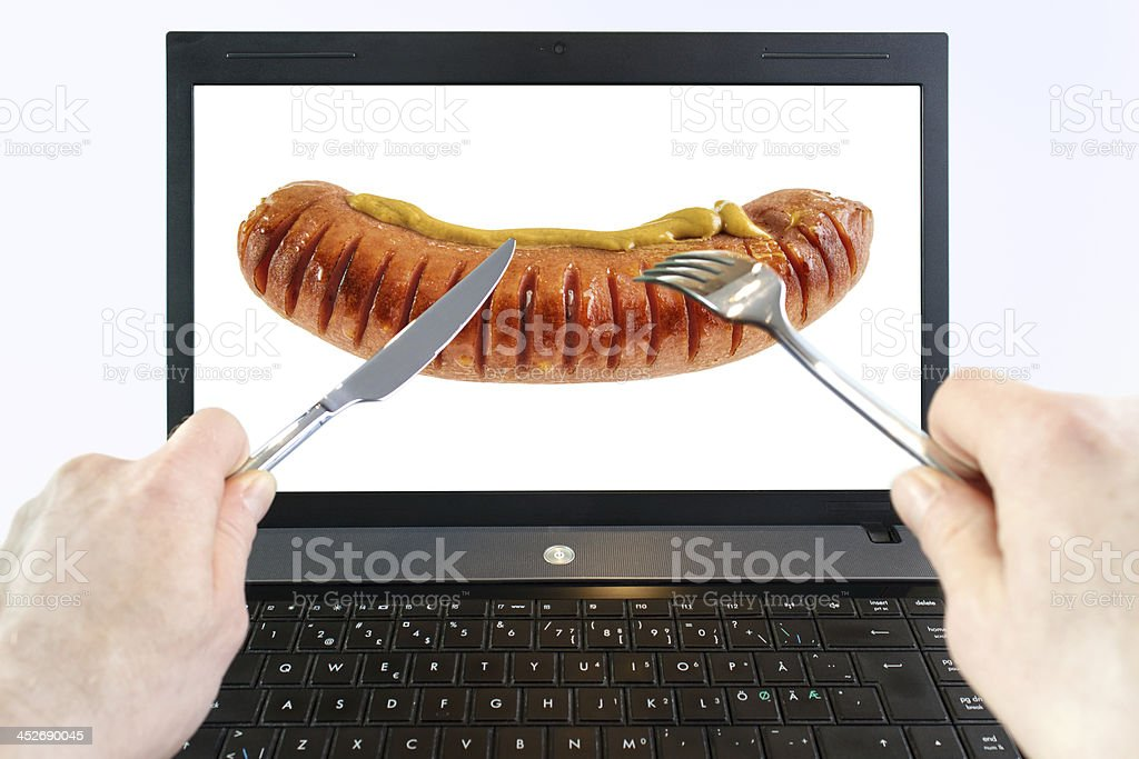 Diner with laptop computer royalty-free stock photo