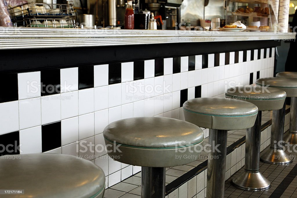 diner-piped green counter stools royalty-free stock photo