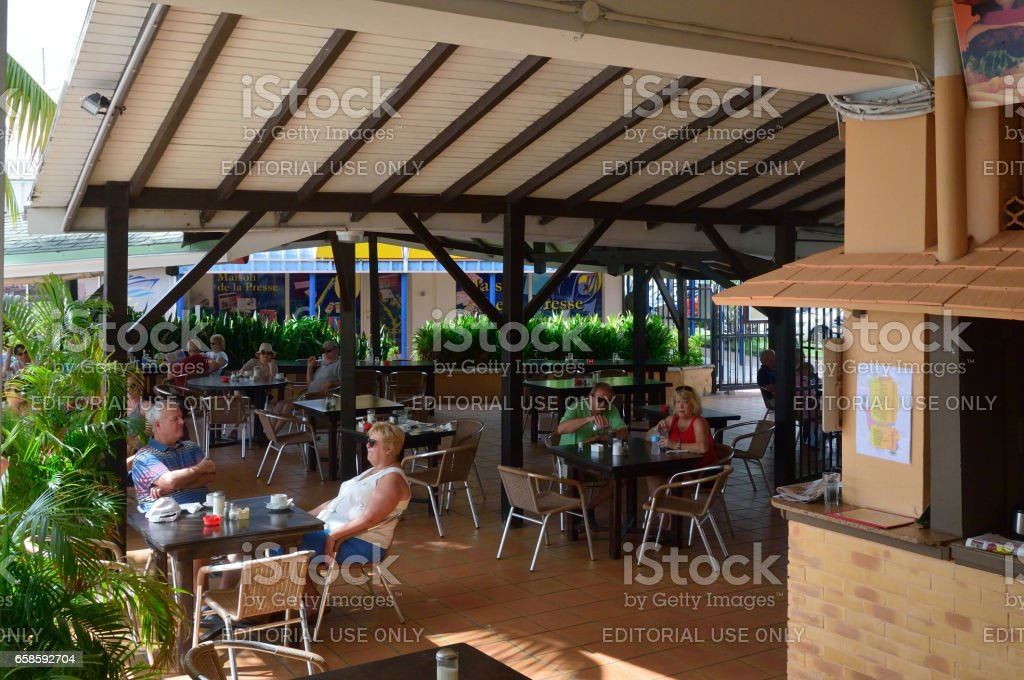 Diners at La Tropicana in Marigot stock photo