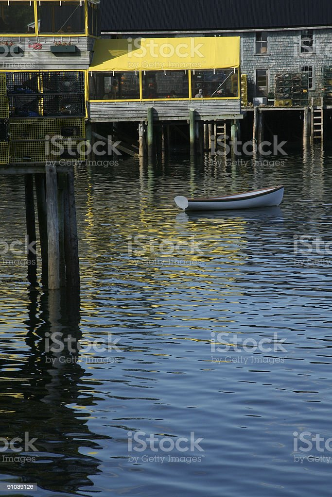 Dinghy and lobster wharf royalty-free stock photo