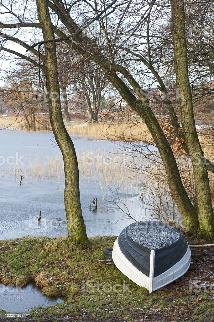 Dinghy at a the Frozen Lake royalty-free stock photo