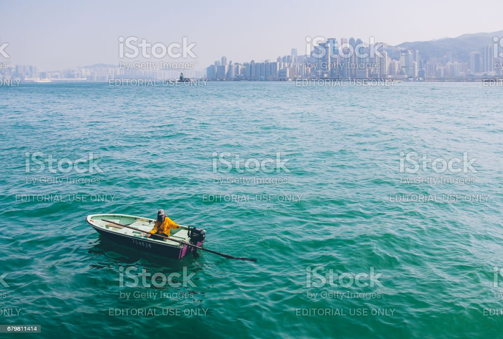 Dinghy Boat in Victoria Harbour beside Avenue of Stars, Hong Kong stock photo