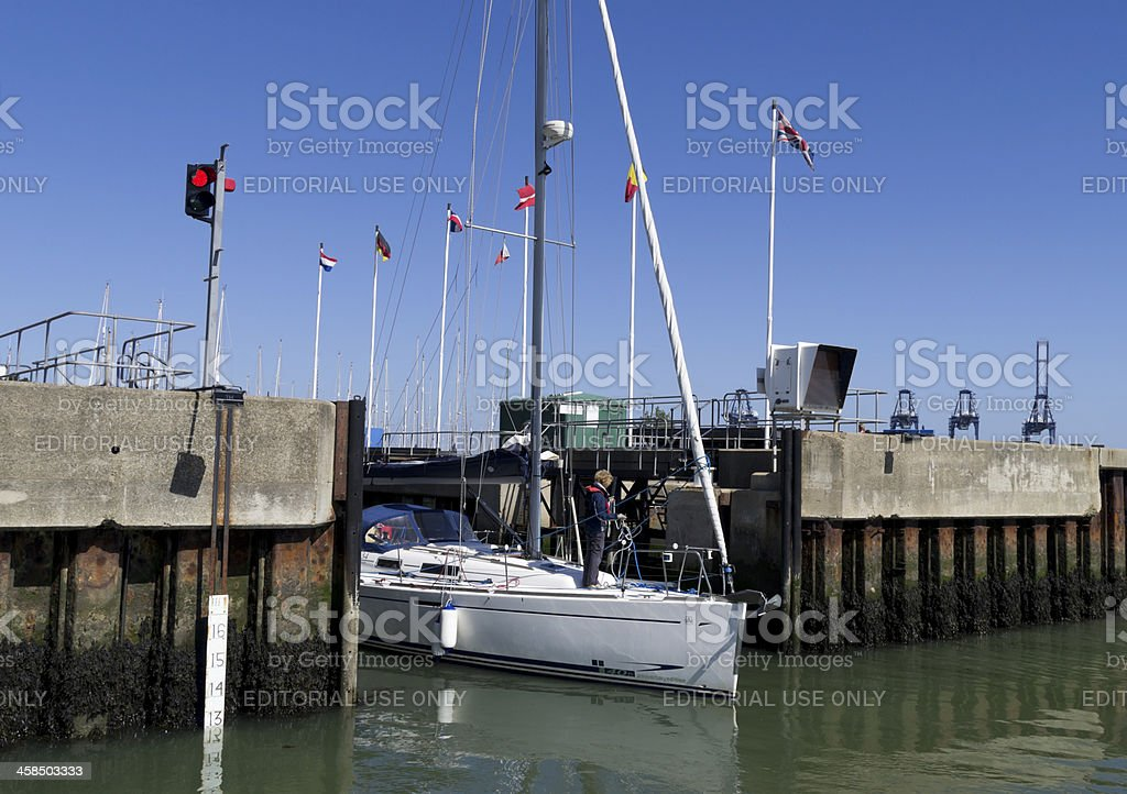 Dinghy exiting the lock at Shotley Marina royalty-free stock photo