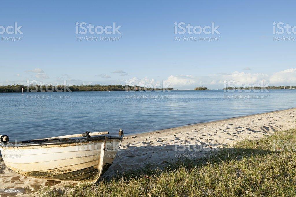 Dinghy on beach. stock photo