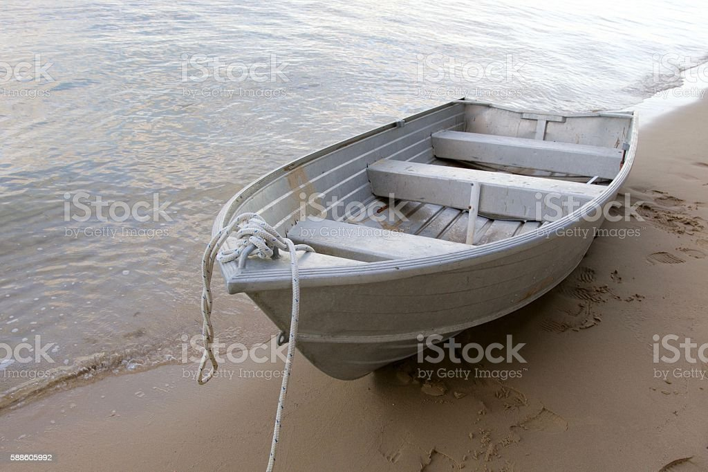 Dinghy on the sand stock photo