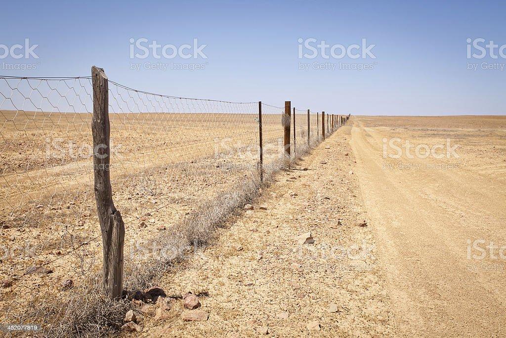 Dingo Dog Proof Fence in Desert Outback Australia stock photo