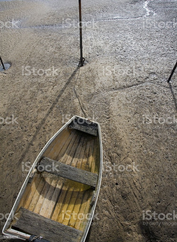 Dingy at low tide royalty-free stock photo