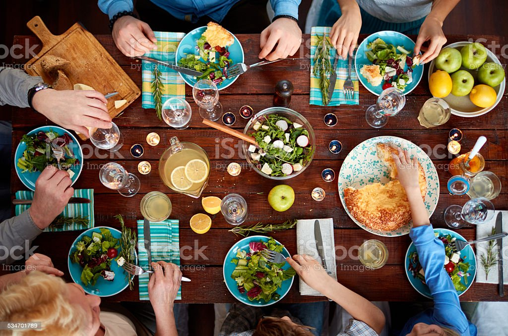 Dining all together stock photo