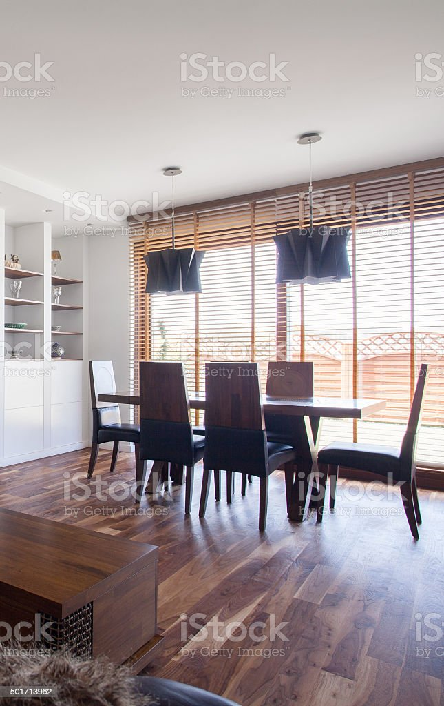 Dining area with big windows stock photo