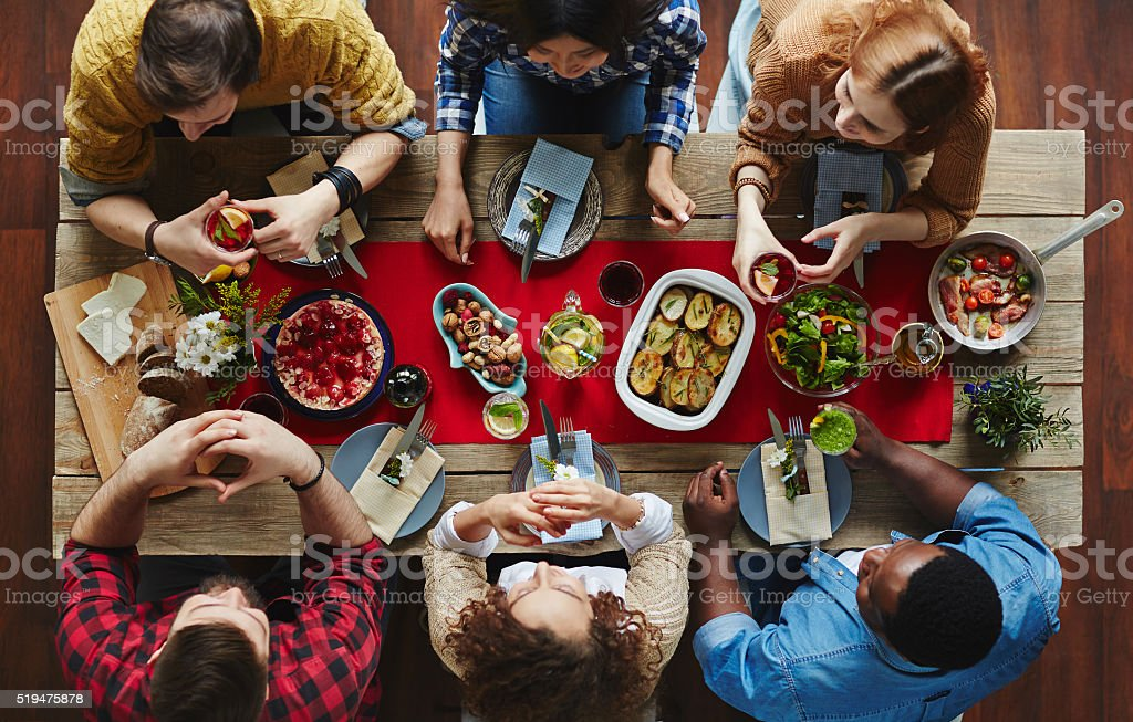 Dining friends stock photo