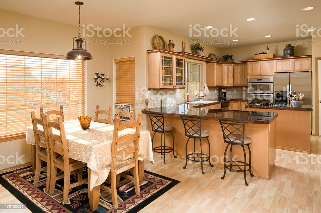 Dining room and kitchen with a breakfast bar stock photo