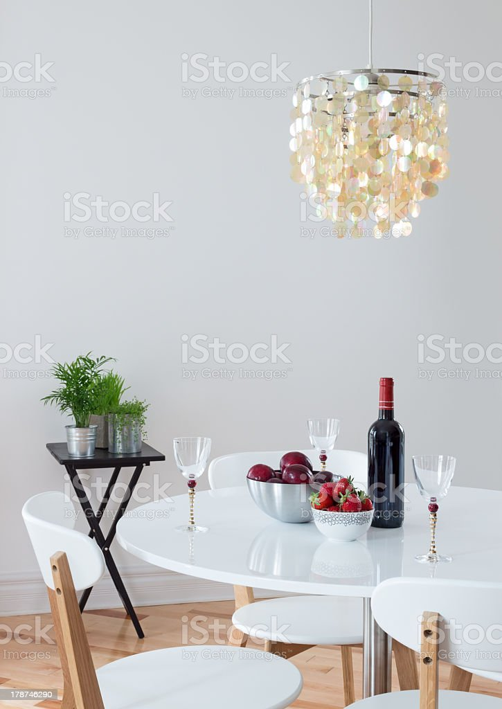 Dining room decorated with beautiful chandelier royalty-free stock photo