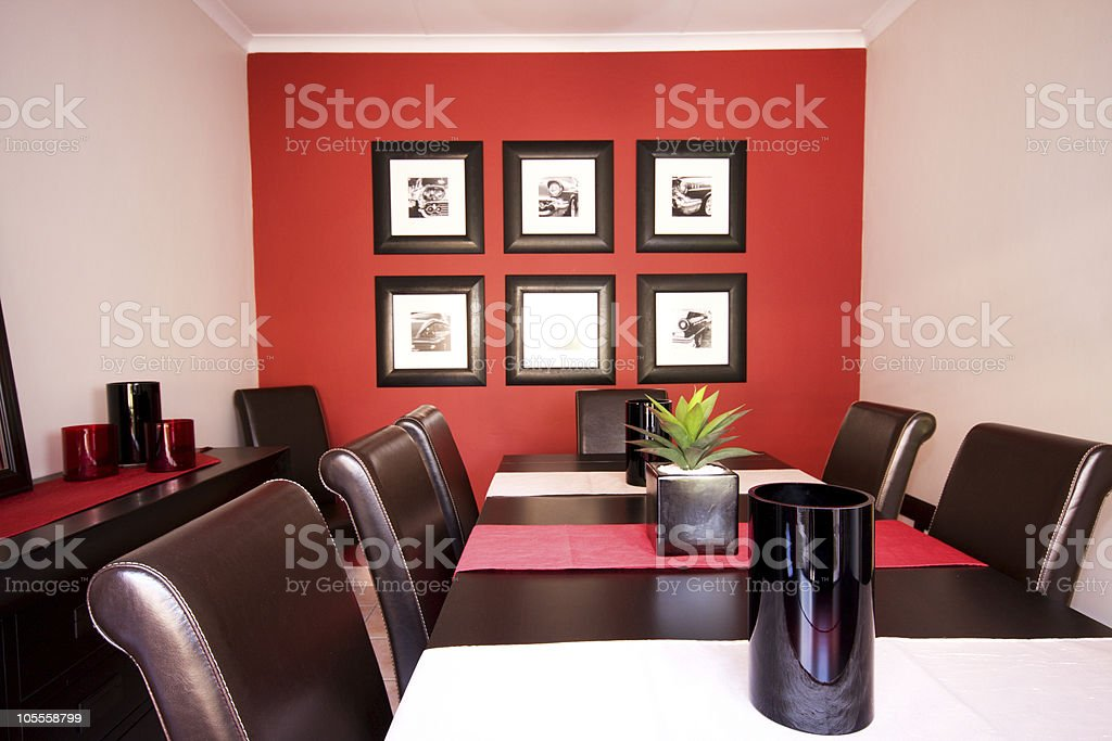 Dining room interior with red wall royalty-free stock photo