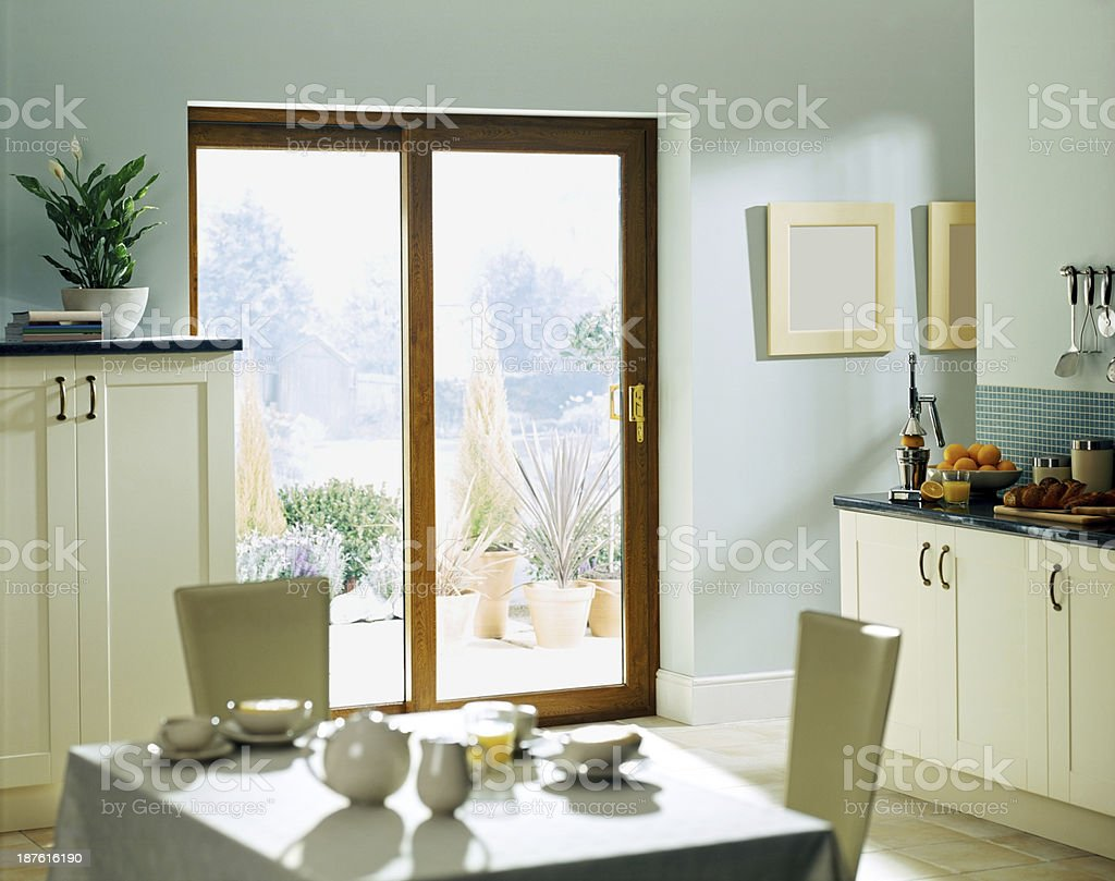 Dining room kitchen with patio doors stock photo