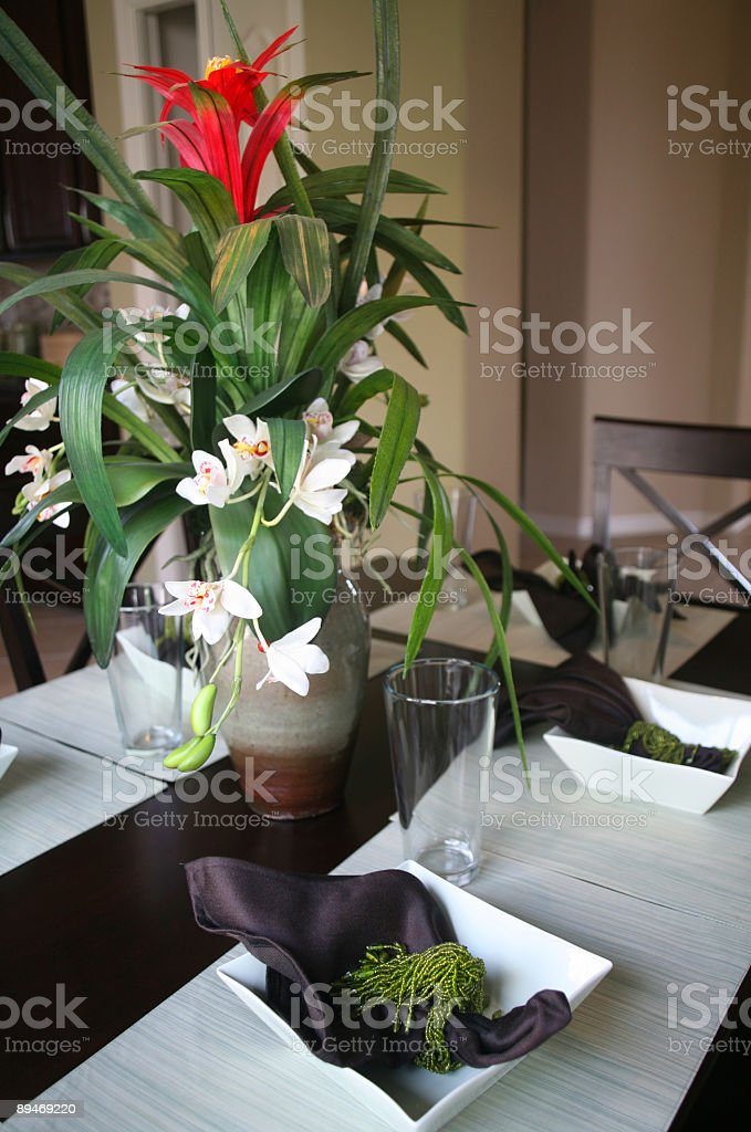 Dining Room Table with Floral Arrangement royalty-free stock photo