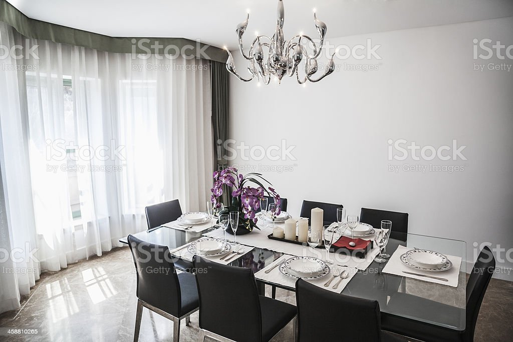Dining room with modern furniture and chandelier. royalty-free stock photo