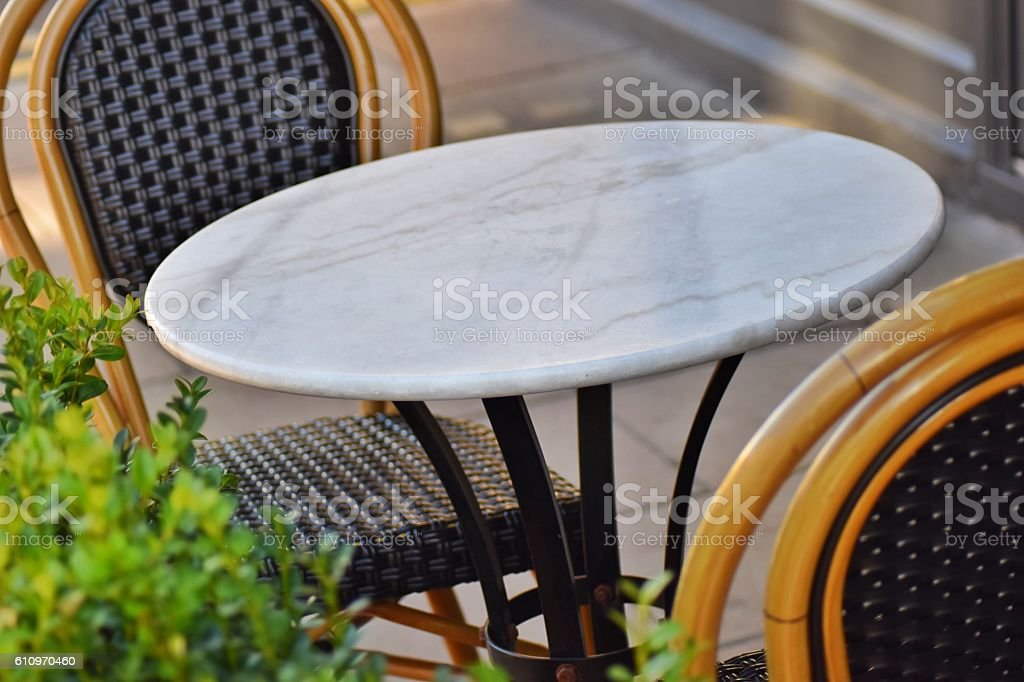 Dining table and chairs alfresco for two stock photo