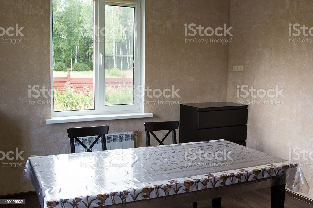 dining table and two chairs in country house stock photo